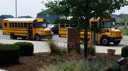 Two new school buses at afternoon line up