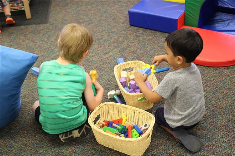 Two little boys playing with blocks