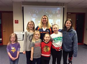 "Mrs. Nagel posing with students after practicing the ""Super Bowl Shuffle"""