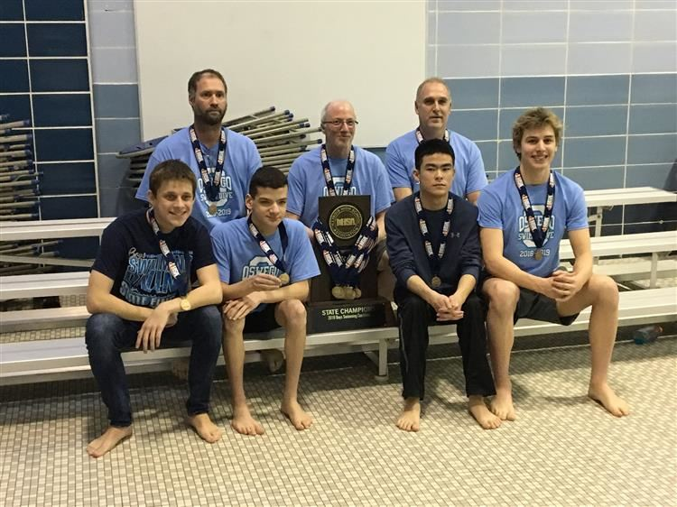 boys and swim and dive team with trophy