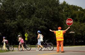 Crossing Guard helping students cross street
