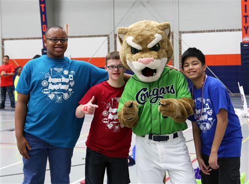 Students with the Kane County Cougar Mascot Ozzie