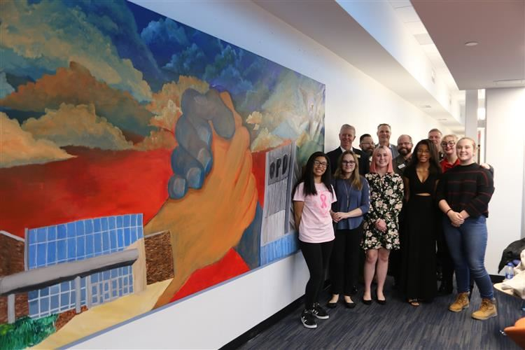 Oswego High School Student with Mural